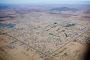 In Arizona City, developments fill in around the city's sparse 18-hole golf course.  Originally, the golf course was built in relative isolation to attract homebuyers in search of inexpensive property.  Reclaimed water from the municiple sewage plant irrigates the course.