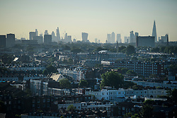 © Licensed to London News Pictures. 14/06/2017. London, UK. A view over the rooftops of Notting Hill in west London showing the London city skyline in the distance, including The Leadenhall Building AKA The Cheese Grater, 30 St Mary Axe AKA The Gherkin, Canary Wharf and the 20 Fenchurch Street skyscraper, AKA the Walkie Talkie Building. Photo credit: Ben Cawthra/LNP