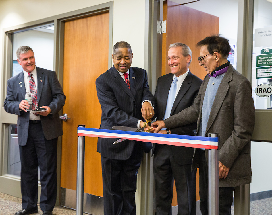 (Left to Right) David W. Edwards, Sr., Ohio University President Roderick McDavis, Danny Abraham and Raymond Abraham participate in the dedication of the Brigadier General James M. Abraham - Colonel Arlene F. Greenfield Veterans and Military Student Services Center. Danny Abraham is General Abraham's son and Raymond Abraham is the General's brother. David W. Edwards, Sr. is the Director of the Center. Photo by Jasmine Beaubien