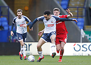 Bolton Wanderers Kean Bryan in action with Sam Finley of Accrington during the EFL Sky Bet League 1 match between Bolton Wanderers and Accrington Stanley at the University of  Bolton Stadium, Bolton, England on 29 February 2020.