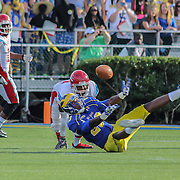 Delaware Cornerback MARIO ROWSON (23) deflects and intercepts a pass in the third quarter of a Week 2 NCAA football game against Delaware State University. <br /> <br /> Delaware defeated Defeated Delaware State 42-21 Saturday. Sept Sept. 07, 2013 in Newark Delaware.