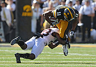 September 29 2012: Iowa Hawkeyes wide receiver Kevonte Martin-Manley (11) is hit by Minnesota Golden Gophers defensive back Michael Carter (23) after a catch during the first quarter of the NCAA football game between the Minnesota Golden Gophers and the Iowa Hawkeyes at Kinnick Stadium in Iowa City, Iowa on Saturday September 29, 2012. Iowa defeated Minnesota 31-13 to claim the Floyd of Rosedale Trophy.