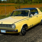 1965 Plymouth Valiant Signet on pavement