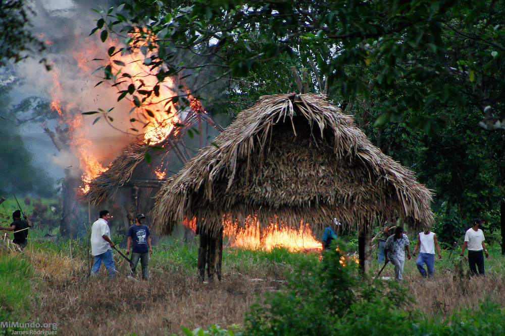 Homes in the community of Barrio La Revolucion are burned and destroyed. On January 8th and 9th, 2007, the Guatemalan Nickel Company, local subsidiary of Canadian Skye Resources, ordered the forced eviction of five Q'eqchi' Mayan communities around Lake Izabal in El Estor, Guatemala. Over 800 State security forces carried out the forced eviction destroying and even burning several huts in the indigenous communities who claim the territory as ancestral land.
