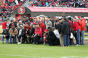 San Francisco 49ers alumni members pose for a group photograph on the field before the San Francisco 49ers 2016 NFL week 11 regular season football game against the New England Patriots on Sunday, Nov. 20, 2016 in Santa Clara, Calif. The Patriots won the game 30-17. (©Paul Anthony Spinelli)