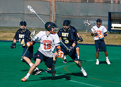 Virginia attackman Garrett Billings (19) runs past Navy defenseman Jordan Dinola (3).  The Virginia Cavaliers scrimmaged the Navy Midshipmen in lacrosse at the University Hall Turf Field  in Charlottesville, VA on February 2, 2008.