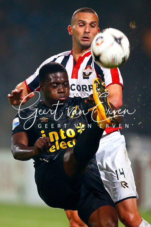 Onderwerp/Subject: Willem II - NAC Breda - Eredivisie<br /> Reklame:  <br /> Club/Team/Country: <br /> Seizoen/Season: 2014/2015<br /> FOTO/PHOTO: Ben SAHAR (R) of Willem II in duel with Isak SSEWANKAMBO (L) of NAC Breda. (Photo by PICS UNITED)<br /> <br /> Trefwoorden/Keywords: <br /> #04 $94 &plusmn;1401920268162<br /> Photo- &amp; Copyrights &copy; PICS UNITED <br /> P.O. Box 7164 - 5605 BE  EINDHOVEN (THE NETHERLANDS) <br /> Phone +31 (0)40 296 28 00 <br /> Fax +31 (0) 40 248 47 43 <br /> http://www.pics-united.com <br /> e-mail : sales@pics-united.com (If you would like to raise any issues regarding any aspects of products / service of PICS UNITED) or <br /> e-mail : sales@pics-united.com   <br /> <br /> ATTENTIE: <br /> Publicatie ook bij aanbieding door derden is slechts toegestaan na verkregen toestemming van Pics United. <br /> VOLLEDIGE NAAMSVERMELDING IS VERPLICHT! (&copy; PICS UNITED/Naam Fotograaf, zie veld 4 van de bestandsinfo 'credits') <br /> ATTENTION:  <br /> &copy; Pics United. Reproduction/publication of this photo by any parties is only permitted after authorisation is sought and obtained from  PICS UNITED- THE NETHERLANDS
