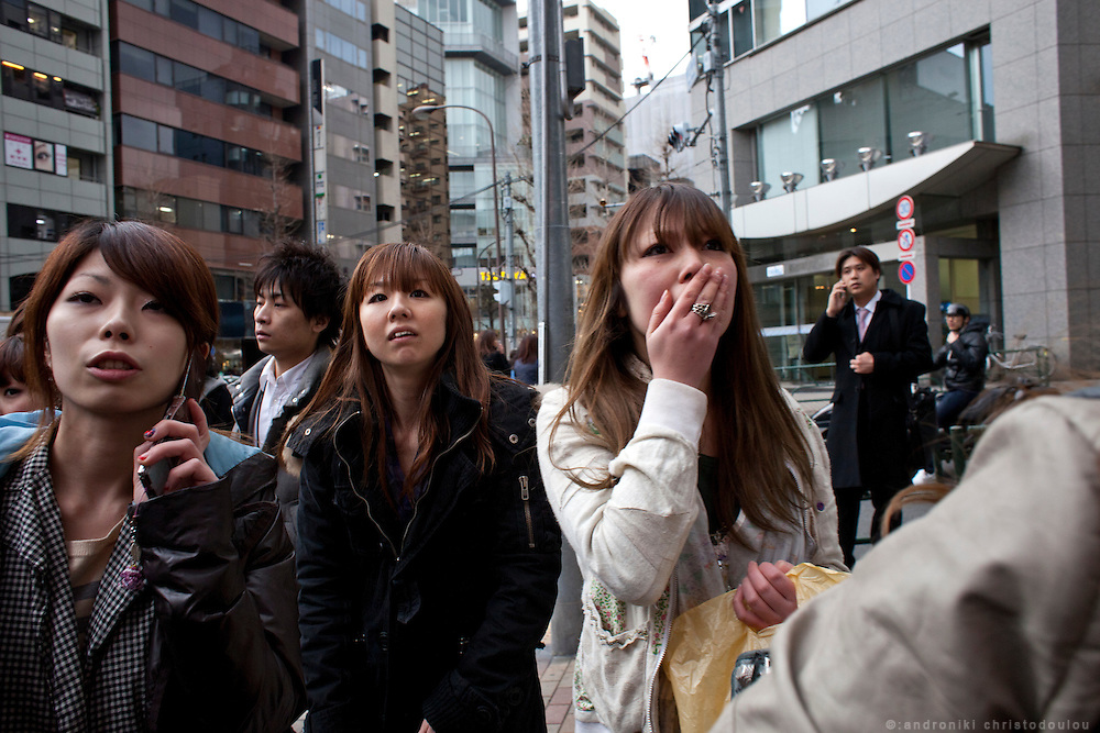 Japanese women watching the news on a TV monitor about the distraction that the earthquake that hit Tokyo around 15:00 on Friday the 11th of March caused.