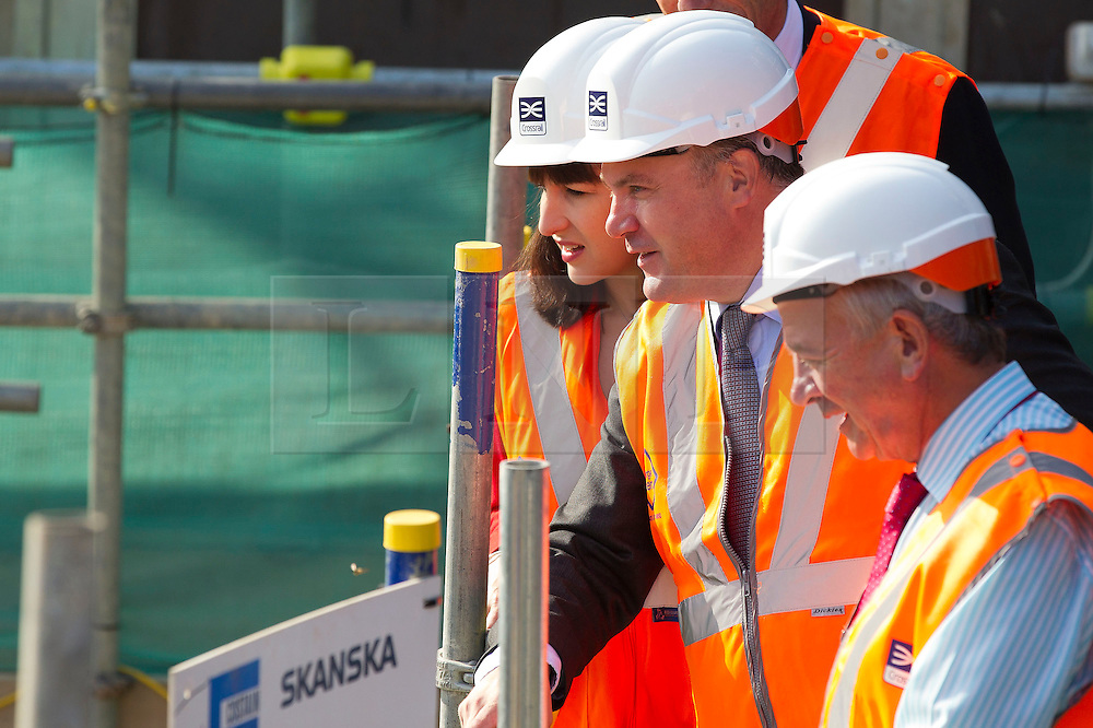 © Licensed to London News Pictures. 05/09/2013. London, UK. Shadow Chancellor Ed Balls (2R) and Shadow Chief Secretary to the Treasury Rachel Reeves (L) receive a progress briefing at the site of the Bond Street Crossrail station in London today (05/09/2013) from Terry Morgan, the chairman of Crossrail. The station forms part of the Crossrail train line, which will be 73 miles (118 km) long when finished in 2018, will connect Maidenhead and Heathrow in the west of London to Shenfield and Abbey Wood in the east, passing under central London to create a new commuter link. Photo credit: Matt Cetti-Roberts/LNP