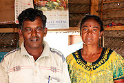 Ramachendrum, 34 and Pangagem, 29, pictured inside their temporary one-room shelter, in the village of Adankulam, near Thunnukai, northern Sri Lanka, March 2010. <br /> <br /> Along with the rest of their family, the couple were  displaced for more than 3 years by the conflict in Sri Lanka.<br /> <br /> They were eventually evacuated by the Red Cross in the final stages of the conflict in April 2009. They then spent 9 months in camp for displaced people near Vavuniya, before they were finally alllowed to return to their village in December 2009.<br /> <br /> They are now trying to rebuild their home and their lives. Their house was destroyed in the fighting, so they are now living in a temporary 'transitional' shelter constructed with the help of UNOPS through a project funded by UKaid from the Department for International Development.<br /> <br /> Ramachendrum used to work in a veterinary centre, but, now he is learning how to cultivate rice paddy, with the help of a small loan also funded by DFID. <br /> <br /> He hopes to one day be able to go back to his old job, but the veterinary centre was also destroyed in the conflict, so for now he is doing the best he can.<br /> <br /> To find out more about how DFID is helping in Sri Lanka, please visit www.dfid.gov.uk ( http://www.dfid.gov.uk ) <br /> <br /> Image: Russell Watkins / Department for International Development