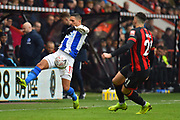 Matias Ezequiel Schelotto (21) of Brighton and Hove Albion controls the ball as Diego Rico (21) of AFC Bournemouth closes in during the The FA Cup 3rd round match between Bournemouth and Brighton and Hove Albion at the Vitality Stadium, Bournemouth, England on 5 January 2019.