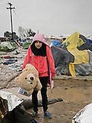 Greece, Idomeni, Refugees on their way to Europe,   Children in Idomeni<br /> <br /> Idomeni, is the eye of a needle for getting to nothern Europe. <br /> Girl and here Teddy from Syria in Idomeni. The family moved the tent from a muddy place to another place, maybe leave Idomeni.<br /> <br /> <br /> <br /> Nadeloehr nach Nordeuropa Idomeni, der Grenzuebergang ist seit Wochen gesperrt,. <br /> Regen und Kaelte machen vor allem den Familien mit kleinen Kindern zu schaffen. <br /> <br /> <br /> <br /> <br /> keine Veroeffentlichung unter 50 Euro*** Bitte auf moegliche weitere Vermerke achten***Maximale Online-Nutzungsdauer: 12 Monate !! <br /> <br /> for international use:<br /> Murat Tueremis<br /> C O M M E R Z  B A N K   A G , C o l o g n e ,  G e r m a n y<br /> IBAN: DE 04 370 800 40 033 99 679 00<br /> SWIFT-BIC: COBADEFFXXX