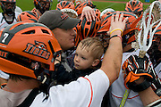 2011/05/14 - RIT Men's Lacrosse Head Coach Jake Coon and his son celebrate with the team after a 13-12 overtime victory over Denison University in the second round of the NCAA tournament.