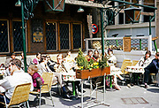 People sitting at tables in sunshine outside Het Brouwers Wapen cafe bar, Amsterdam, Netherlands 1971