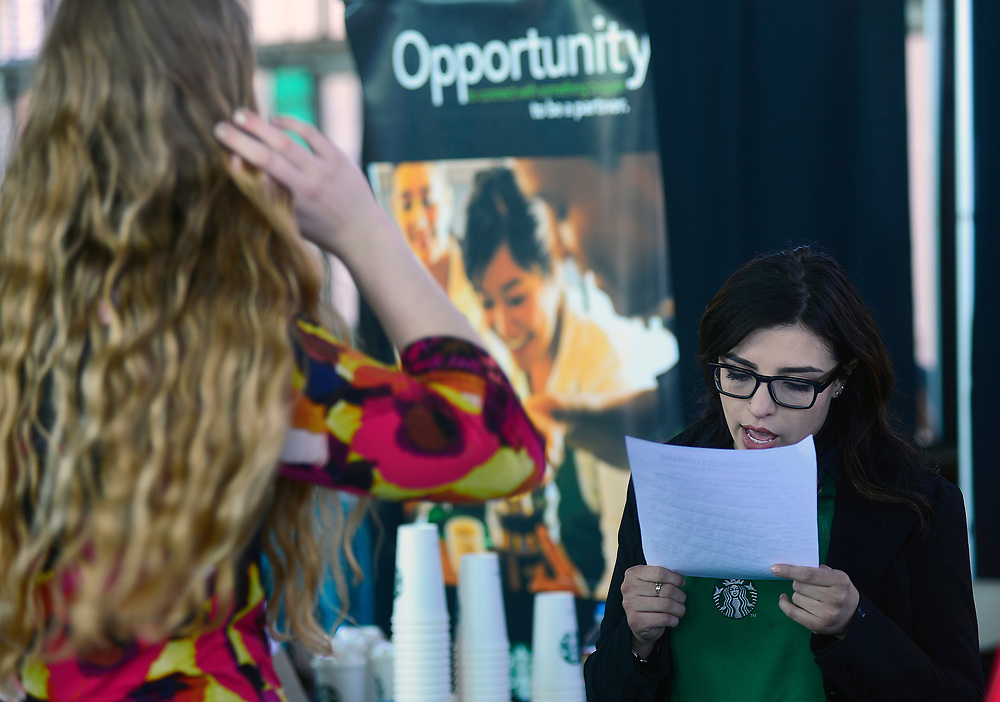 apl051117j/BUSINESS/pierre-louis/JOURNAL 051117<br /> Starbucks Shift Supervisor Alexis Brown,,  right examines UNM student Hannah Tobiassen,,'s job application  during the Job-Ready-Hire Fair held at the Railyards  .Photographed on Thursday May 11 2017. .Adolphe Pierre-Louis/JOURNAL