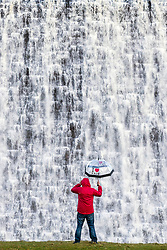 "© Licensed to London News Pictures. 11/03/2020. Derwent UK. Water cascades down the dam wall of Derwent Reservoir in Derbyshire this morning after weeks of heavy rainfall. The dam is famed for being used during the Second World War by the RAF's 617 Squadron ""Dam busters"" to practise low level flying needed for operation Chastise. Photo credit: Andrew McCaren/LNP"