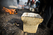 The empty casing of a computer monitor lays on the ground while boys burn plastic off cables from electronics to recover copper near the Agbogboloshie market in Accra, Ghana on Tuesday August 12, 2008.