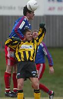 Fotball. 1. divisjon 14. april 2002. Tollnes - Tromsdalen i Skien. Sebastien Goldstein, Tromsdalen vinner mot Morten Romsdalen, Tollnes.<br /> <br /> Foto: Andreas Fadum, Digitalsport.