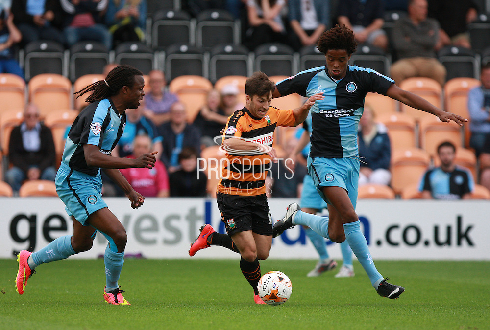 Luke Gambin exploits the space between Marcus Bean and Sido Jombati during the Sky Bet League 2 match between Barnet and Wycombe Wanderers at Underhill Stadium, London, England on 15 August 2015. Photo by Bennett Dean.