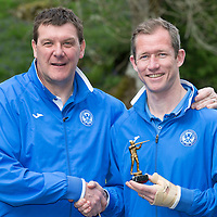 St Johnstone players enjoy a bit of rest and realxation at the Dunkeld Hilton before this weekend's William Hill Scottish Cup Final....12.05.14<br /> Manager Tommy Wright presents a trophy to clay pigeon shooting winner Frazer Wright<br /> Picture by Graeme Hart.<br /> Copyright Perthshire Picture Agency<br /> Tel: 01738 623350  Mobile: 07990 594431