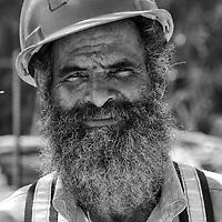 Lo llamaban Fidel, por su larga barba y aspecto en general. Un obrero con mucha experiencia por sus largos años de trabajo en el area. En una mega construccion son muchas las personas que trabajan y laboran en ella, pero son principalmente los obreros lo que realizan la mayor fuerza de trabajo. Varian de estado, pais, edad, pero todos realizan algo en comun, el trabajo duro a pleno sol en una obra tras obra. Es su forma de ganarse la vida, y quizas sea la unica que conocen. Son solo 36 retratos de muchos que laboran. Una pequeña muestra. Rasgos y miradas de una fuerza lab oral. They called him Fidel, because of his long beard and general appearance. A worker with a lot of experience for his long years of work in the area. In a mega construction are many people who work in it, but the workers are mainly what do most workforce. Vary from state, country, age, but they all perform something in common, hard work in the sun in construction after construction It's their way of living, and perhaps it is the only one known. It's only 36 portraits of many who work. A small sample. Features and looks of a workforce. La Guaira, 2013, 2014. Venezuela