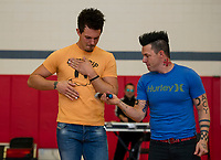 Ryan Vezina and Justin Spencer of Recycled Percussion show how they make music with their body during a surprise visit to Laconia Middle School on Monday afternoon.  (Karen Bobotas/for the Laconia Daily Sun)
