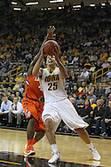 November 29, 2011: Iowa Hawkeyes guard/forward Eric May (25) drives to the basket as Clemson Tigers guard Rod Hall (4) defends during the first half of the NCAA basketball game between the Clemson Tigers and the Iowa Hawkeyes at Carver-Hawkeye Arena in Iowa City, Iowa on Tuesday, November 29, 2011. Clemson defeated Iowa 71-55 in the Big Ten-ACC Challenge game.