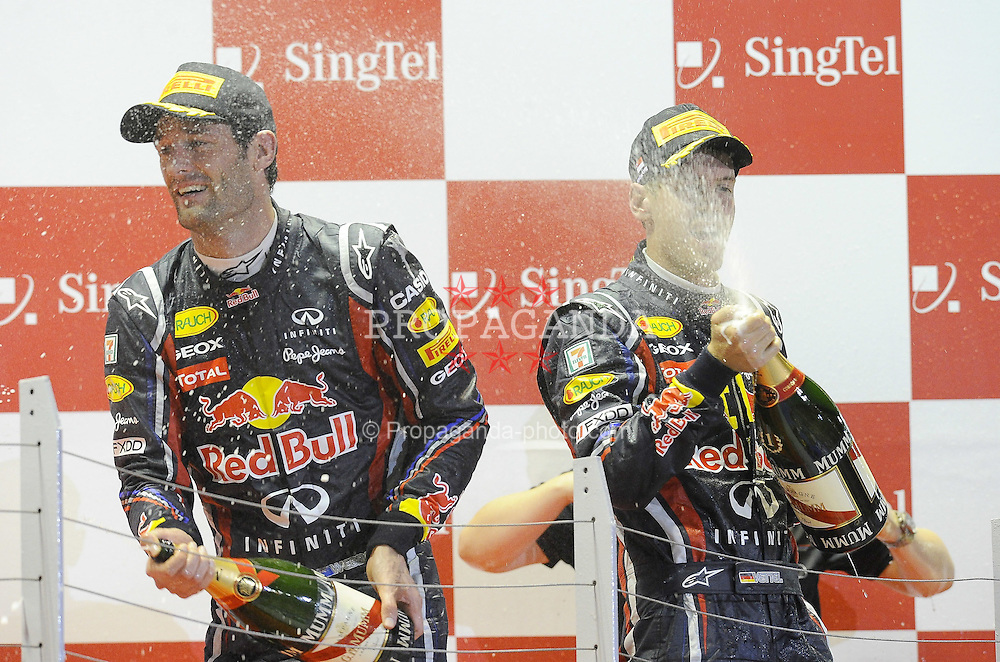25.09.2011, Marina-Bay-Street-Circuit, Singapur, SIN, F1, Grosser Preis von Singapur, Singapur, im Bild Podium -  Mark Webber (AUS), Red Bull Racing - Sebastian Vettel (GER), Red Bull Racing // during the Formula One Championships 2011 Large price of Singapore held at the Marina-Bay-Street-Circuit Singapur, 2011-09-24  EXPA Pictures © 2011, PhotoCredit: EXPA/ nph/  Dieter Mathis       ****** out of GER / CRO  / BEL ******