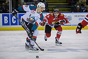 KELOWNA, CANADA - JANUARY 21:  Kelowna Rockets left wing Calvin Thurkauf #27 and Portland Winterhawks defenseman Matthew Quigley #5 at the Kelowna Rockets game on January 21, 2017 at Prospera Place in Kelowna, British Columbia, Canada.  (Photo By Cindy Rogers/Nyasa Photography,  *** Local Caption ***