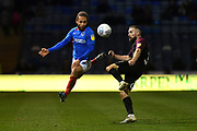 Portsmouth's Marcus Harness and Peterborough's Dan Butler during the EFL Sky Bet League 1 match between Portsmouth and Peterborough United at Fratton Park, Portsmouth, England on 7 December 2019.