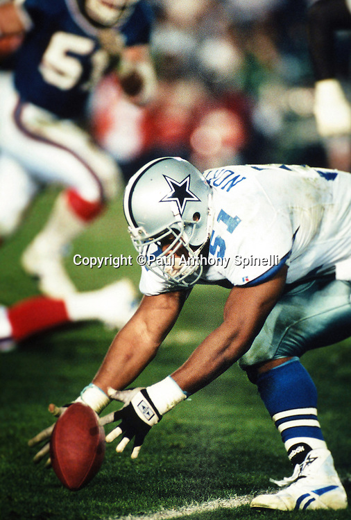 Dallas Cowboys linebacker Ken Norton, Jr. (51) recovers a fumble and runs for a 9 yard touchdown during the NFL Super Bowl XXVII football game against the Buffalo Bills on Jan. 31, 1993 in Pasadena, Calif. The Cowboys won the game 52-17. (©Paul Anthony Spinelli)