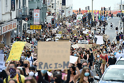 © Licensed to London News Pictures. 11/07/2020. Brighton, UK. Crowds gather to take part in a Black Lives Matter demo on Brighton seafront in East Sussex.  Photo credit: Liz Pearce/LNP