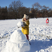 A chinese family play in the snow at Central Park after New York City was hit with over 7 inches of snow during its first winter storm of the year. Central Park, Manhattan, New York, USA. 4th January 2014 Photo Tim Clayton