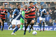 Birmingham City midfielder Jacques Maghoma  attempts to tackle Queens Park Rangers midfielder Massimo Luongo during the Sky Bet Championship match between Birmingham City and Queens Park Rangers at St Andrews, Birmingham, England on 17 October 2015. Photo by Alan Franklin.