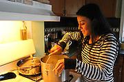 Kearny, New Jersey. November 19, 2013. Yadira Aleman cooks soup in her kitchen in Kearny. Photo by Maya Rajamani/NYCity Photo Wire