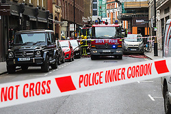 Soho, London, May 8th 2015. Firefighters deal with a fire that broke out at lunchtime in the kitchens of Carom and Floridita, a pair of Wardour Street restaurants in the heart of Soho. The cause is still being investigated. PICTURED: Police cordons seal off the scene preventing workers from returning to their offices.
