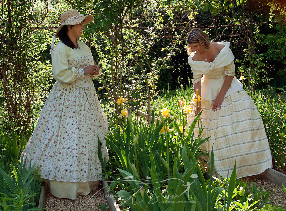 Stacy Clark and Wynell Leigh walk through the gardens at Colonnade, a historic home in Columbus, Miss. April 17, 2010. The 1840 home, and its expansive garden, was among nearly two dozen sites on tour during Columbus' annual Spring Pilgrimage. (Photo by Carmen K. Sisson/Cloudybright)