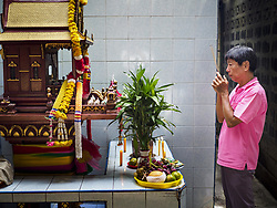 September 5, 2017 - Bangkok, Bangkok, Thailand - A man prays at spirit house in Bangkok's Chinatown district on Hungry Ghost Day. The Ghost Festival is a Buddhist and Taoist holy day celebrated on the 15th day of the 7th lunar month. It is primarily celebrated in China and Chinese communities outisde China. In Thailand, it's celebrated in Thai-Chinese communities in Bangkok, Phuket and Chiang Mai.  On that day ghosts and spirits, including those of the deceased ancestors, come out from the lower realm to visit the living. Families prepare elaborate banquets for the spirits and burn ''ghost money'' for the spirits to use in the other realm. It is a day for venerating dead relatives. (Credit Image: © Jack Kurtz via ZUMA Wire)
