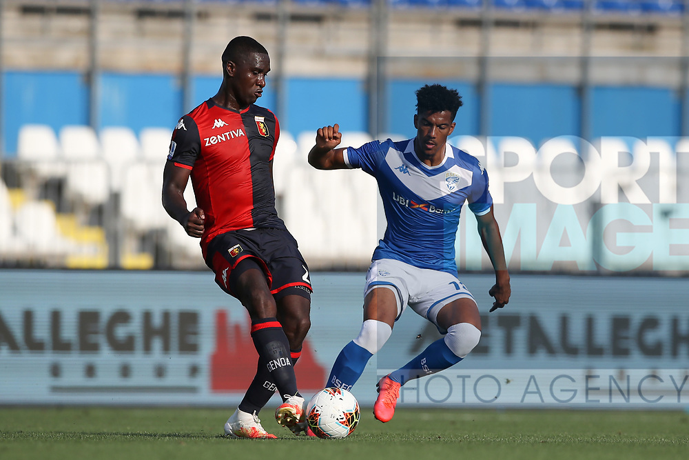Brescia Calcio's French striker Florian Aye closes in on Genoa's Colombian defender Christian Zapata during the Serie A match at Stadio Mario Rigamonti, Brescia. Picture date: 27th June 2020. Picture credit should read: Jonathan Moscrop/Sportimage