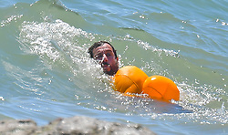 EXCLUSIVE: Adam Sandler takes a dip in the ocean fully clothed even wearing shoes and socks. The funny man was seen spending time with his two daughters having a great time splashing around as they swam in the pacific. Adam kept his shorts, shirt, socks and shoes on to go into the water, and managed to have a pretty great time. 11 Jul 2020 Pictured: Adam Sandler. Photo credit: MEGA TheMegaAgency.com +1 888 505 6342