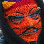 Close up of  &quot;Anonymous&quot; wearing winter wool mask protester in Washington Square Park.<br /> <br /> Anonymous is a group initiating active civil disobedience and spread through the Internet while staying hidden, representing the concept of many online community users simultaneously existing as an anarchic, digitized global brain. <br /> <br /> It is also generally considered to be a blanket term for members of certain Internet subcultures, a way to refer to the actions of people in an environment where their actual identities are not known.<br /> <br /> <br /> Grassroots, nonviolent efforts of  street protests, following the deaths of Eric Garner, Michael Brown and Akai Gurley have helped America talk more openly about race and to see meaningful changes in law enforcement practices and accountability mechanisms.<br /> <br /> The protesters, who were black, white, Latino, Asian, young and elderly, streamed through  New York. They carried protest signs that read &ldquo;Hands Up, Don&rsquo;t Shoot&rdquo; and banners that read &ldquo;Black Lives Matter&rdquo;.