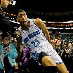 Jan 1, 2013; New Orleans, LA, USA; New Orleans Hornets power forward Anthony Davis (23) fans into the first row of fans courtside after saving a loose ball during the fourth quarter of a game against the Atlanta Hawks at the New Orleans Arena. The Hawks defeated the Hornets 95-86. Mandatory Credit: Derick E. Hingle-USA TODAY Sports