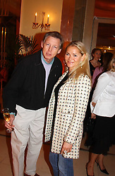 JOHN STEPHENS of China White and CHRISTINA KNUDSEN at the 2005 Clicquot Award - Business Woman of The Year award ceremony held at Claridge's, Brook Street, London W1 on 28th April 2005.