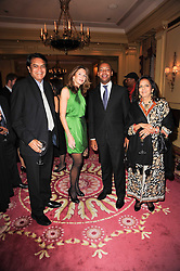 Left to right, SATISH MODI, KIM ROBSON ORTIZ, PAUL PEARSON and  ABHA MODI at a reception hosted by Films Without Borders at the Lanesborough Hotel, Hyde Park Corner, London on 27th October 2010.