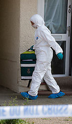 © licensed to London News Pictures. Braintree, UK  06/06/2011. A forensics officer carrying ambulance equipment out of 40 Bartram Avenue in Braintree, Essex today (06/06/2011) where the bodies of a woman and a child were found following a shooting. Officers were called to reports of a firearms incident in the early hours of the morning. Photo credit should read Ben Cawthra/LNP