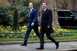 © Licensed to London News Pictures. 12/03/2019. London, UK. Secretary of State for Health and Social Care Matt Hancock (L) and Foreign Secretary Jeremy Hunt (R) arrive on Downing Street for a meeting of the Cabinet. MPs will get a second meaningful vote on Prime Minister Theresa May's Brexit deal this evening. Photo credit: Rob Pinney/LNP