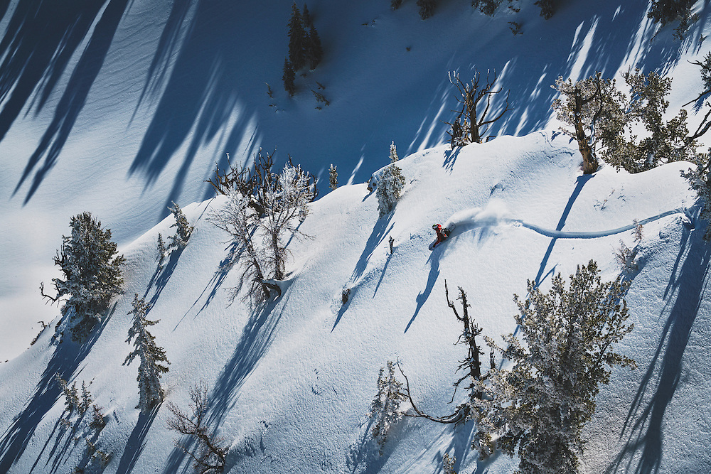 Splitboarder Maxwell Morrill takes a creative line while riding in the Wasatch Mountains, Utah.