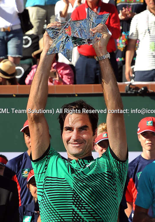 INDIAN WELLS, CA - MARCH 19: ATP player Roger Federer (SUI) with the winners trophy after defeating Stan Wawrinka (SUI), on March 19, 2017, 6-4, 7-5 to become the 2017 BNP Paribas Open Champion in a tournament played at the Indian Wells Tennis Garden in Indian Wells, CA. (Photo by John Cordes/Icon Sportswire)