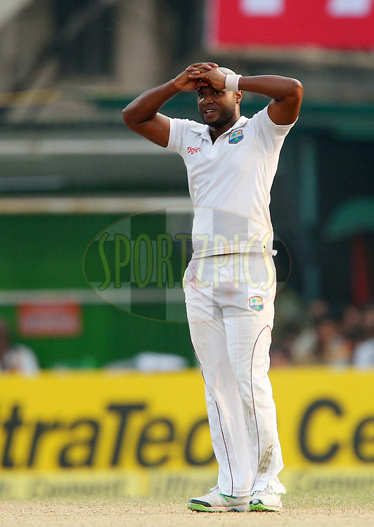 Tino Best of West Indies reacts after a delivery  during day two of the first Star Sports test match between India and The West Indies held at The Eden Gardens Stadium in Kolkata, India on the 7th November 2013<br /> <br /> Photo by: Ron Gaunt - BCCI - SPORTZPICS