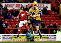 Jens Hegeler and Bailey Wright of Bristol City beat Jamie Ward to a header - Mandatory by-line: Robbie Stephenson/JMP - 21/01/2017 - FOOTBALL - The City Ground - Nottingham, England - Nottingham Forest v Bristol City - Sky Bet Championship